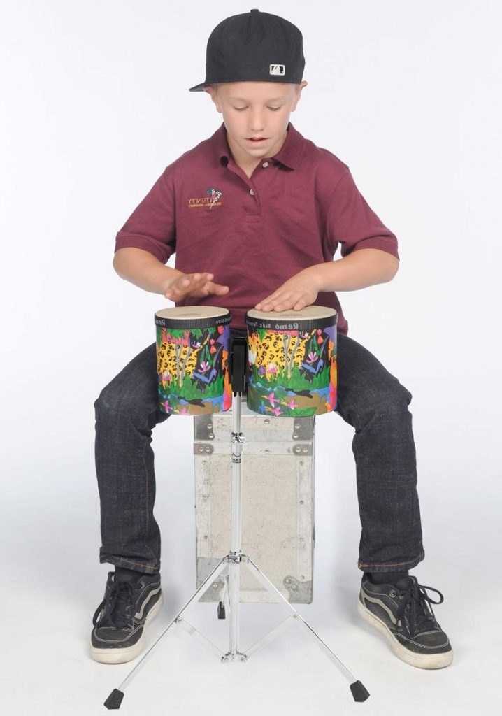 kid playing bongos