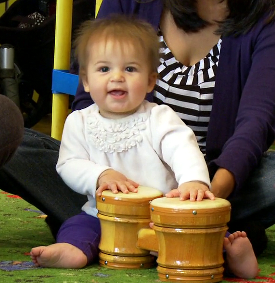 baby playing bongos